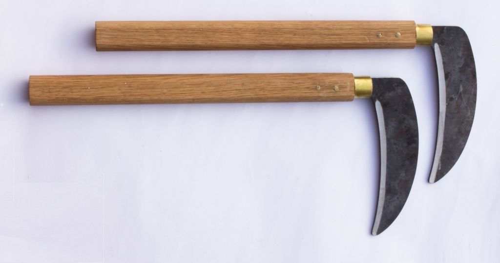 Metal Kama. Heat-treated steel blade mounted in oak handle with tung oil finish. By Seaholme Carpentry.